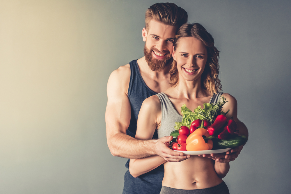 fit couple with vegetables