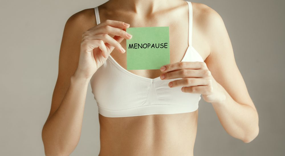 woman and menopause sign