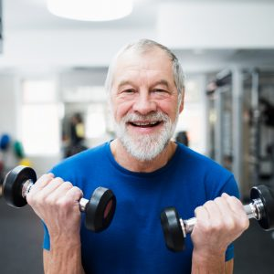 senior man dumbbell curls