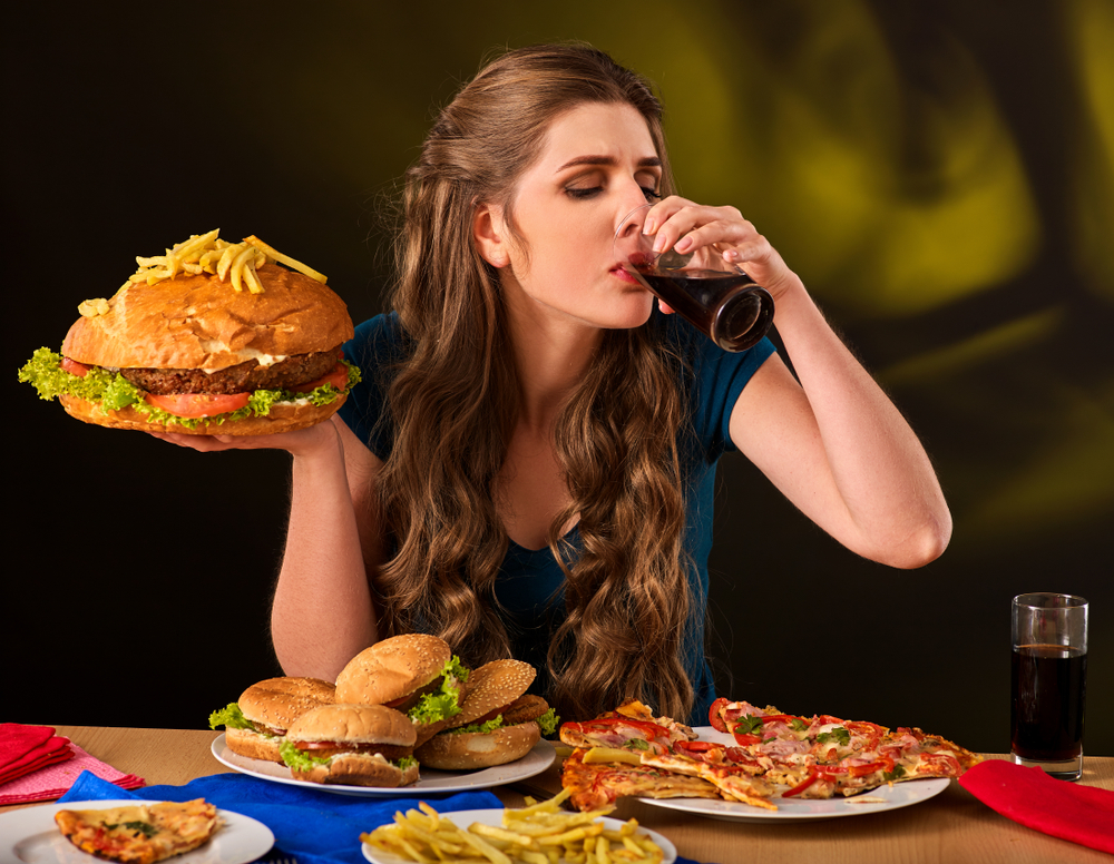 woman binge eating