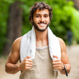 man with towel on shoulders after a run