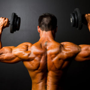 shutterstock_102169051 ripped guy muscular back shoulder press dumbbells
