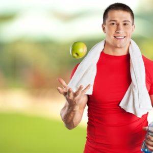 shutterstock_301190801 man having an apple after workout