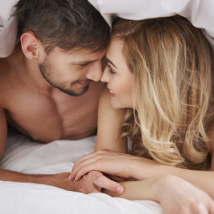 shutterstock_316339565 intimate couple under the covers
