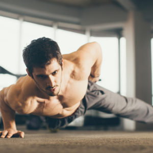 muscular guy one hand push up