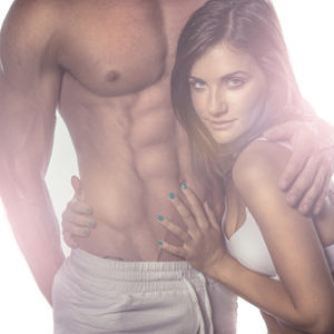woman holding guy's ripped abs hugging