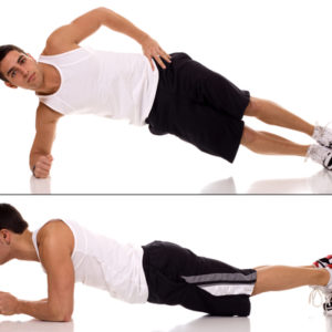 man doing side plank yoga