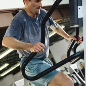 sweaty guy working out in gym with equipment