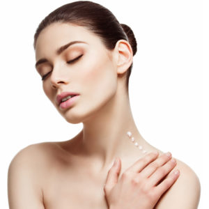 woman stretching neck applying cream neck therapy