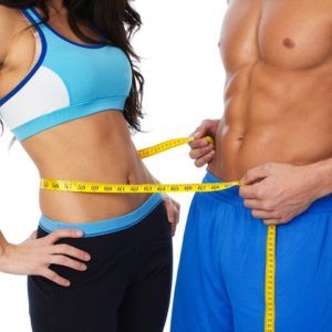 fit couple with abs measuring waist