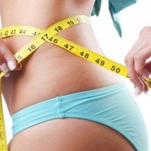 woman measuring waist after weight loss