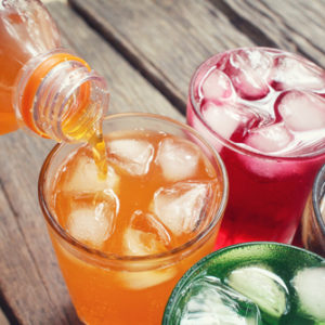 glasses of different colored soda