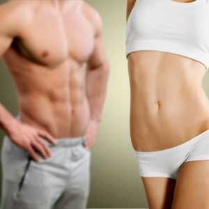 fit couple showing flat belly and abs