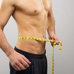 fit man measuring waist line