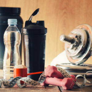 weight loss essentials dumbbell and protein powder