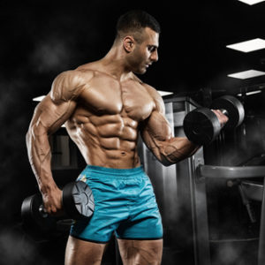 muscular guy lifting heavy weights for bicep curls