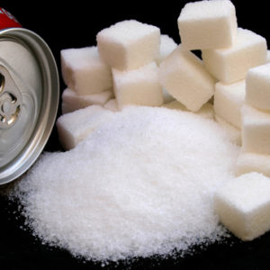 sugar cubes and can of soda