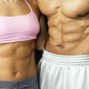 fit couple showing ripped abs