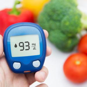 glucose meter showing blood sugar level
