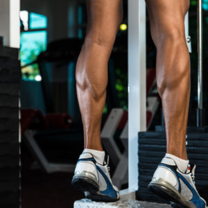 toned legs doing standing calf raise