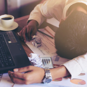 tired man fell asleep at work on desk