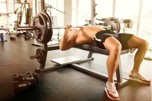 fit guy doing barbell bench press