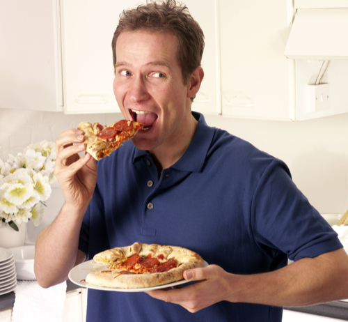 man eating pizza alone