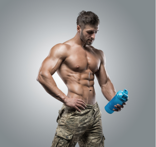 muscular guy who takes Progentra holding water bottle