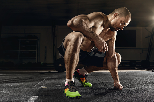 fit muscular man working out and takes Progentra