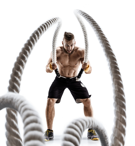 muscular guy working with battle ropes has more stamina