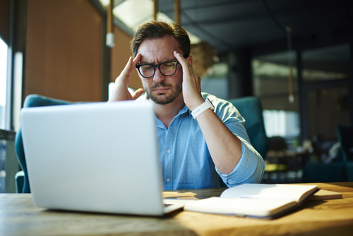 man having headache at work