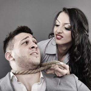 controlling woman holding rope around man's neck