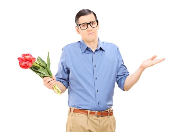 nerdy guy holding bouquet of flowers