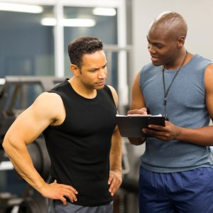 gym instructor teaching man