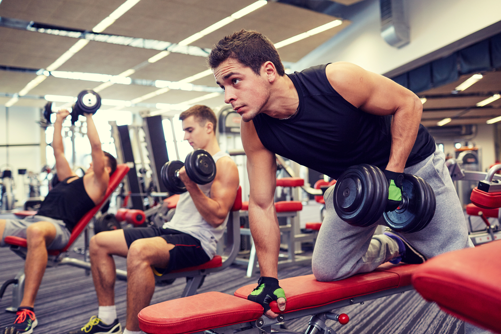 men working out in gym with weights