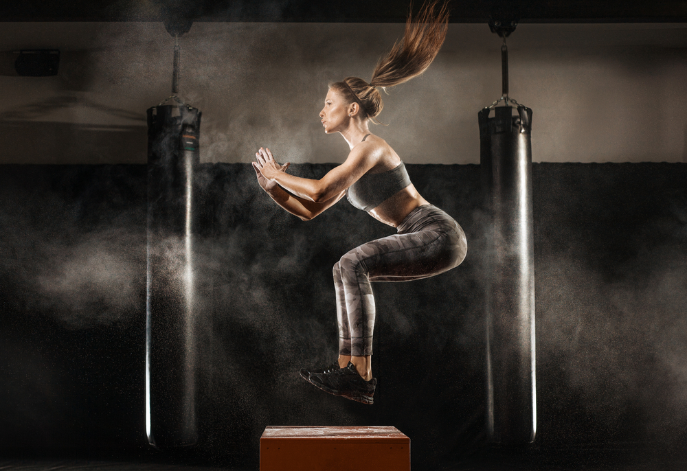 athletic woman doing box jumps