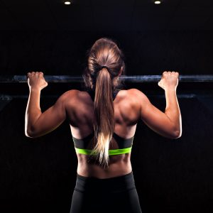 woman doing pull ups, grip strength