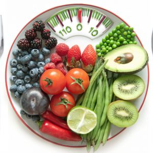 nutritious fruit and vegetable on scale plate