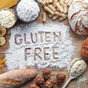 Gluten free written in flour surrounded by bread and pasta