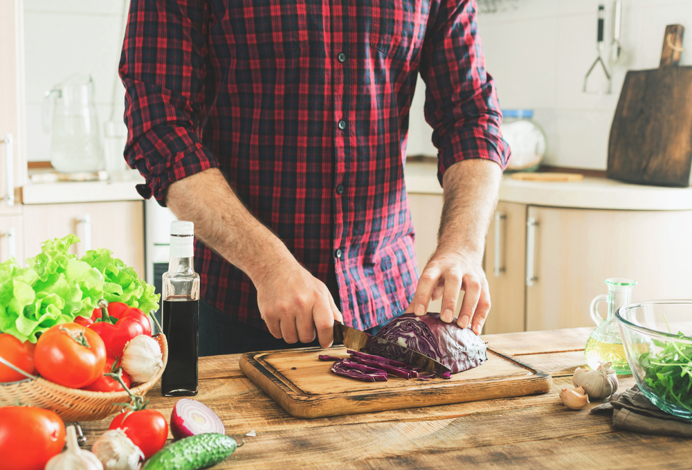 man living healthier with preparing meal at home