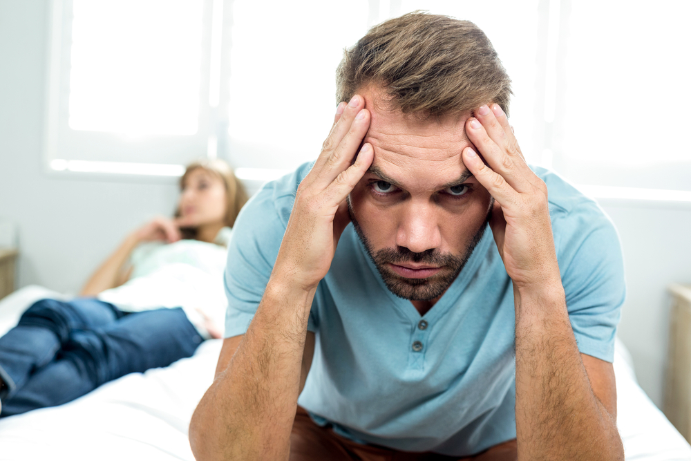 man frustrated with controlling wife