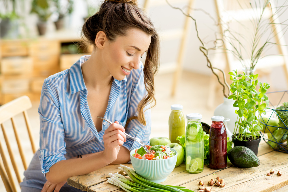 woman eating salad and healthy food, diet