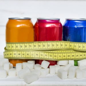sugar loaded soda in can with tape measure