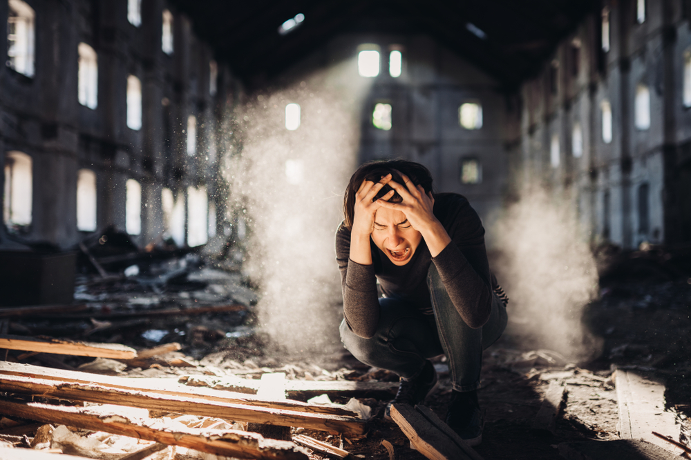 crying man in ruined building