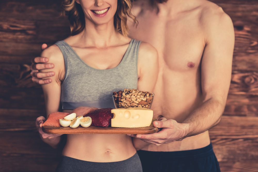 fit couple holding post workout meal protein rich food