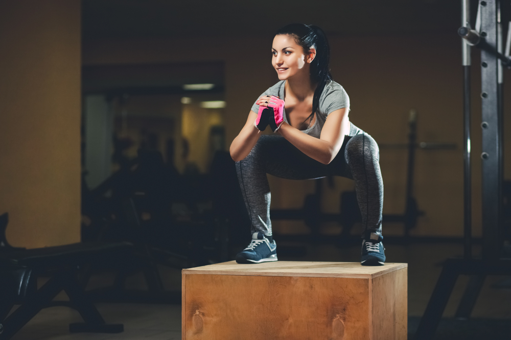 woman doing box jump squats