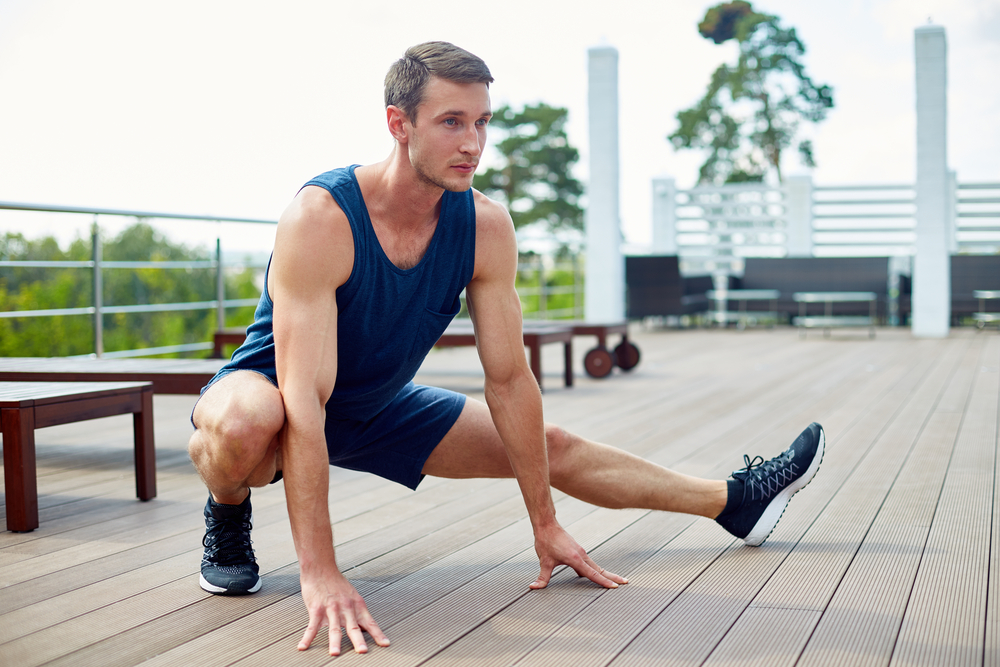 man doing side lunges and regularly takes sexual enhancement pills